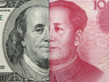 Паритетный курс юаня к доллару США ослаб на 35 базисных пунктов